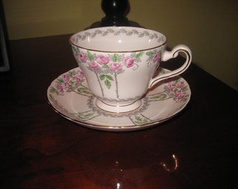 Royal Tuscan Pink and Green Rose Teacup and Saucer