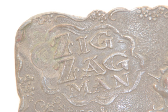 Zig Zag Man - Rolling Papers - vintage belt buckle