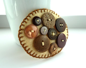button brooch brown -- Unique brown button on cream beige felt pin badge OOAK