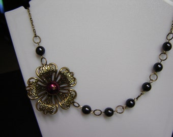 Antique brass necklace with black Czech glass pearls and brass flower with burgundy pearl