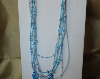 White and Turquoise beaded six strand necklace