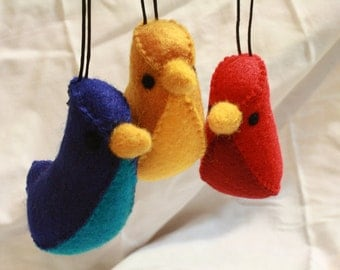 "set of red, blue and yellow ""banana bird"" felt ornaments"