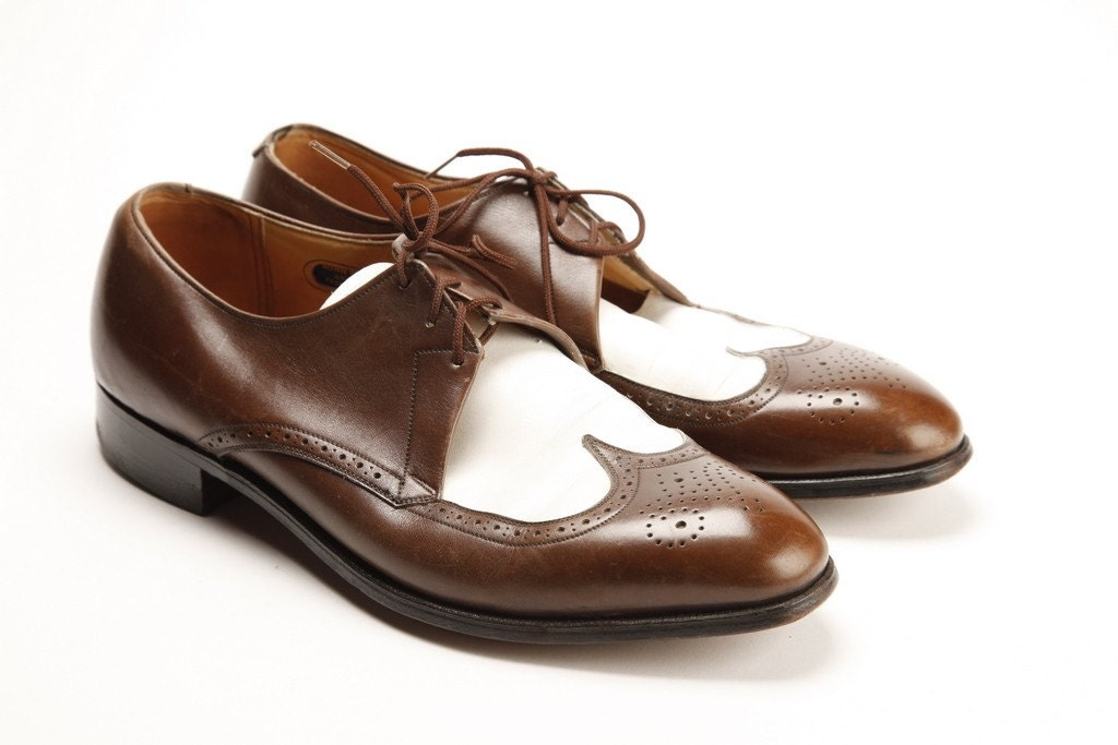 brown and white two tone wing tip shoes