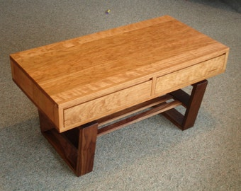 Mid century modern styled coffee table or bench with drawers.