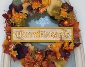 Happy Harvest Wreath of Autumn colors of orange, fall rustic, maple brown, golden, burgandy, purple. Faux berries, gladiolas