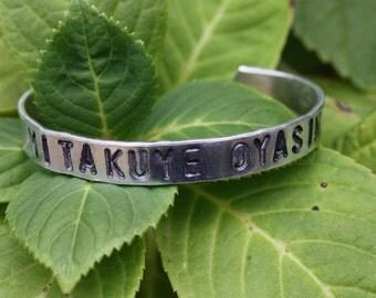 MITAKUYE OYASIN All My Relations - Two Feathers Jewelry - Lakota Phrase - Hand Stamped Cuff Bracelet - Aluminum - Native American Inspired