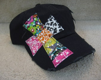 Black baseball hat with cross by Two Girls Who Make Crosses