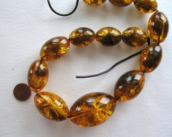 Huge amber probably  resin necklace