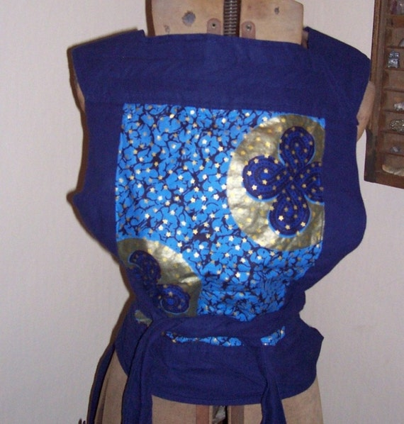 Amazingly comfortable, reversible, reinforced, Mei tai styled baby carrier