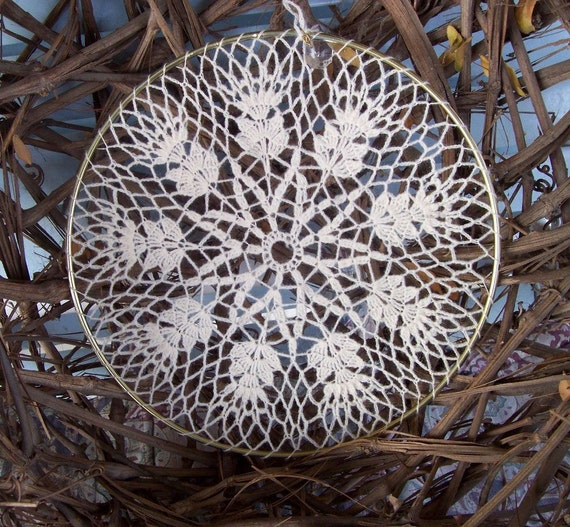 Delicate eye-catching crochet window or wall hanging with a small crystal