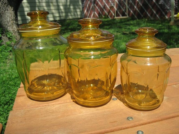 Amber glass canisters with lids in graduating sizes