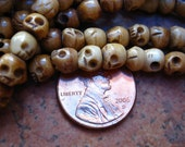 Carved Bone Skull beads - 5x6 mm strand of 75