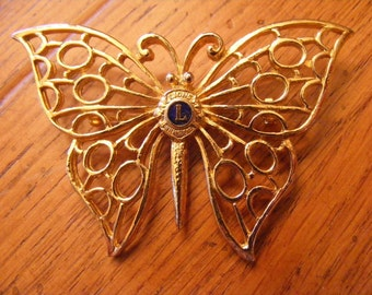 Gold Butterfly Brooch with Letter L-Lions International
