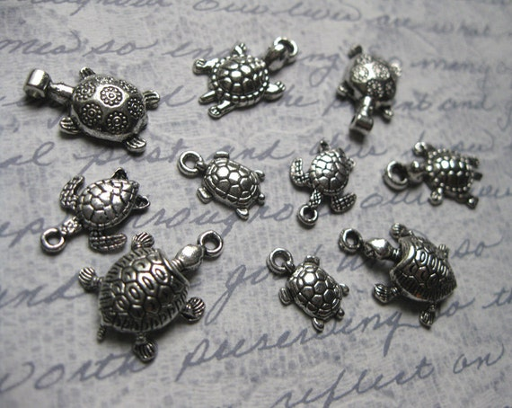 Collection of 10 turtle charms / pendants in silver tone - C891