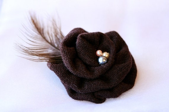 Soft rolled cozy clip with feather and beads