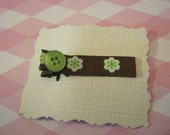 Green and brown button clip