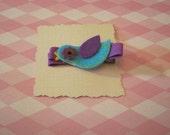 Purple and blue bird clip