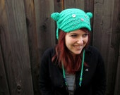 KITTY HAT, Green (crochet ear-flap hat with embroidered cat face). Sales donated to cat rescue group.