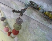Felted balls necklace in pale autumn colors on bronze chain