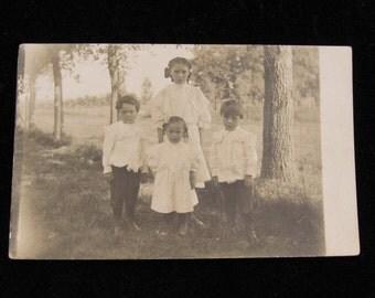 Circa 1910  Siblings in Cotton Whites  Vintage Photograph Postcard          RPPC
