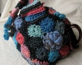 Tea Cozy made in Freeform Crochet and knitting - blue, pink, and charcoal with a hat