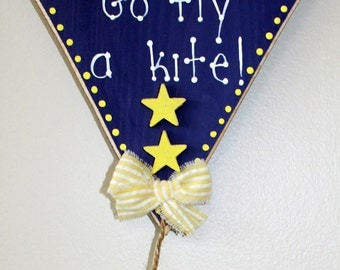 Wooden Purple and Yellow Go Fly a Kite Sign