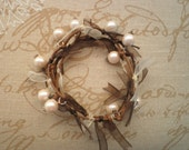 Pearl bracelet, with brown and ivory ribbons and silver details