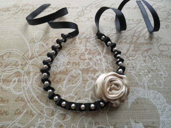 Reserved listing for Kristie - Pearl bracelet, with flower. Black bracelet with ivory flower and tiny ivory pearls