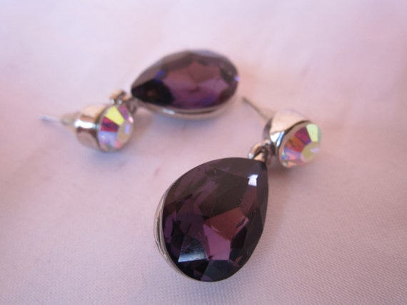 Amethyst crystal color beads with crystal clear bead accents and silver metal holder fashion earrings.