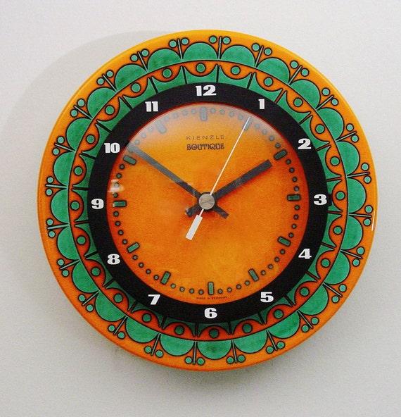 orange pottery wall clock kienzle boutique mid century