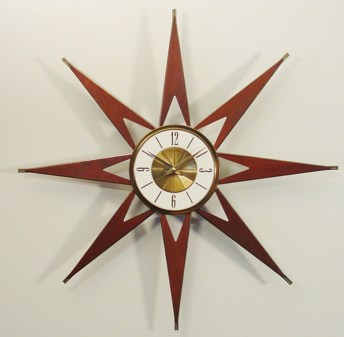 mid century modern starburst clock by elgin atomic by clubmoderne. Black Bedroom Furniture Sets. Home Design Ideas