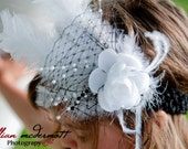 Black and White headband with flower, feather and french netting.