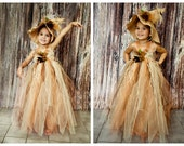 Scarecrow tutu dress. Crocheted top and with raffia . Flower and crow embellishments