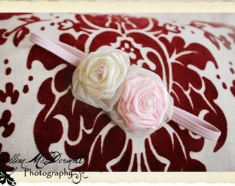 Absolutely beautiful handrolled rosettes wrapped in ivory tulle along with a pearl and pink rhinestone embellishment.