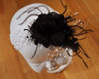 Black and White crocheted headband with flower, pearl and feather embellishments