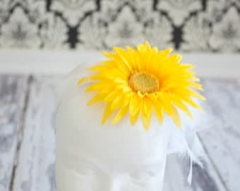 Yellow flower headband with feather embellishments