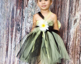 Bumblebee tutu dress. Crocheted  top yellow and black. Comes with matching headband and wings. Flower embellishments