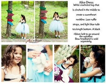 Alice inspired tea lenght tutu dress. White crocheted top with frilly lace straps and a black ribbon belt.  Headband sold separately.