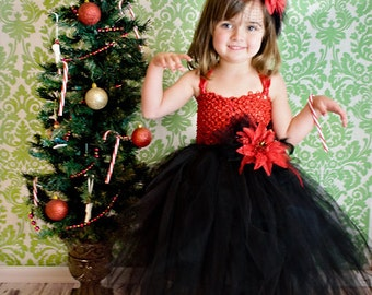 Holiday flower dress with red and black feathers. Black Tulle and red double crochet top to prevent it being see-through. Black trim.