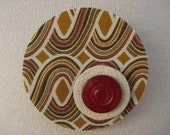 OOAK round brooch in retro print fabric, white leather circle and cherry red button.
