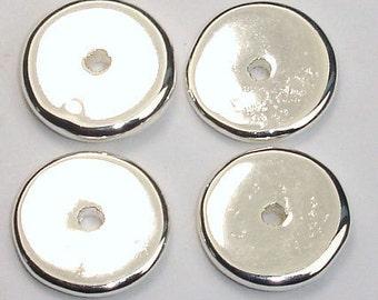 Five 16mm Greek ceramic silver washers