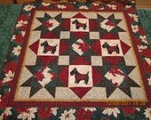 Black Scottie Dog Christmas Quilt with Fabrics of Plaid, Holly, and Poinsettias