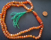 Carved by hand red Agate Tasbih.  Reserved