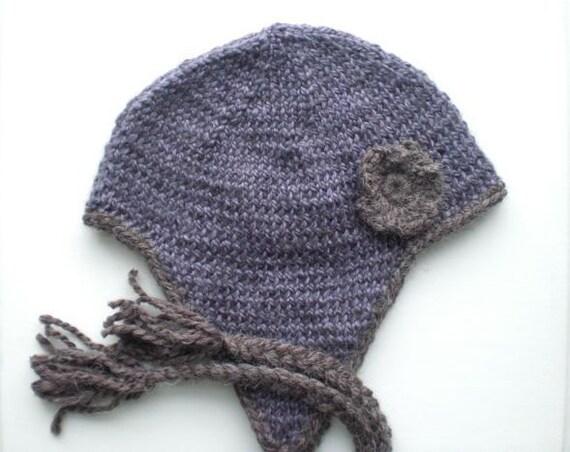 Knitted alpaca helmet. Deep violet purple lavender. Earthy brown trim and flower decoration.