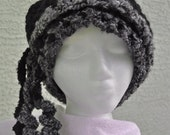 Black and Grey Crocheted Hat with Grey and Black Curled Tassels