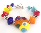 Bright Bird Lampwork Bracelet, Abstract  Bright Bird  Lampwork Glass Bracelet, Handmade Lampwork Glass Sterling Silver Bracelet - PizzazzledDesigns