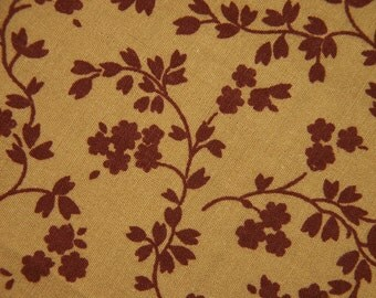 Vintage 1960s quilt fabric in highquality unused cotton with small vinered flower/leafe pattern on mustard brown bottomcolor