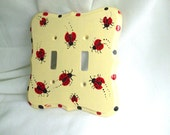 Hand painted ladybug switch plate.