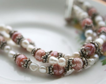 Fresh water pearls with silver 3 strand bracelet