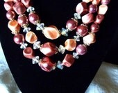 Vintage Triple Strand Bib Necklace Peachy Pink and Mauve Coppery Tone Beads with Aurora Borealis Glass Crystal Spacers Costume Jewelry